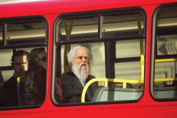 Socrates sitting on top deck of London bus
