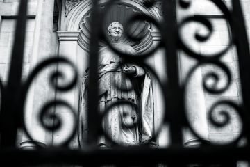 Statue behind a fence