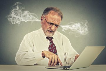 Stressed man at computer
