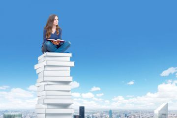 Student sitting high above city