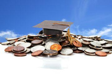 Graduation hat on money
