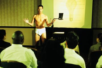 A man lecturing in his underwear