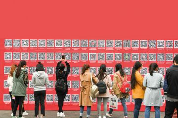Students in China take pictures of QR codes at a jobs fair