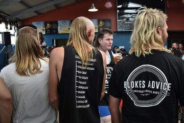 Men wait to be judged on their mullet hairstyles at Mulletfest 2018 in the town of Kurri Kurri, 150 kms north of Sydney, Australia