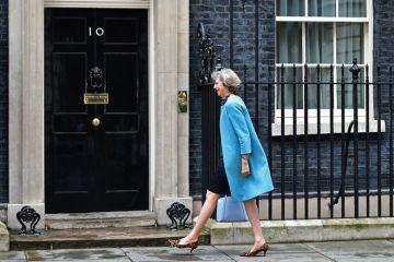 Theresa May entering 10 Downing Street, London