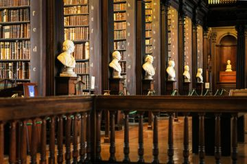 Thousands of books on shelves inside the Trinity College Library Dublin