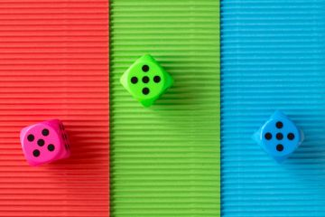Three coloured dice rolling five