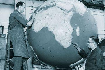 Men painting globe