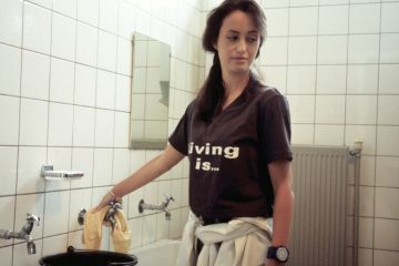 Young cleaning lady unhappy with work