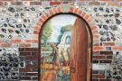 An open door with a painting behind it