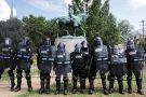 Armoured state police guarding statue