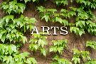 Arts Building sign covered in ivy