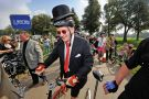 Man wearing suit and bowler hat on a bicycle