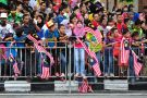 Crowd of people waving Malaysian flags