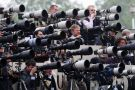 Crowd of press photographers aiming cameras
