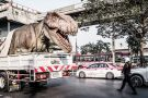 A huge plastic dinosaur in the back of a lorry