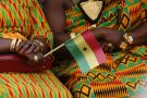Women in kente dresses with Ghana flag