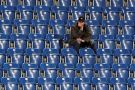 Man sitting alone in empty stadium