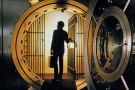 Man walking into bank vault