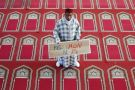 "Muslim man holding ""Not in my name"" placard, Arrahma Mosque, Nantes, France"