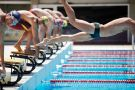 Professional swimmer diving on false start