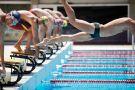 Professional swimmer diving on false start