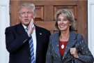 Donald Trump standing with Betsy DeVos