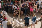 Spectators watch large domino pieces collapse