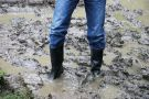 Man wearing boots stuck in the mud