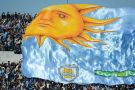 A flag passes over the crowd in Uruguay