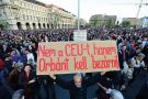 "A man holds up a sign with the text 'Don't close CEU, Orban in to the jail"" as students and teachers of the Central European University protest. Hungary"
