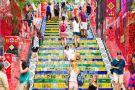 Tourists visiting Selaron stairway, Rio de Janeiro, Brazil
