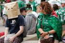Winnipeg Blue Bomber fan hides head in paper bag