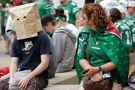 Winnipeg Blue Bomber fan hides head in paper bag