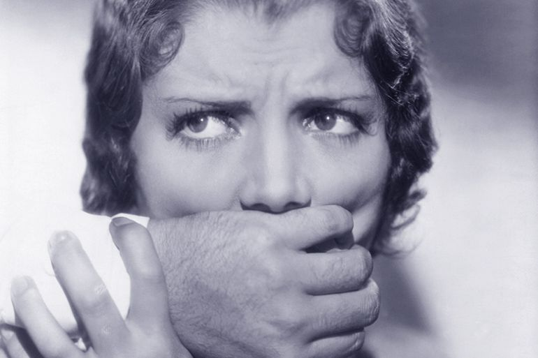 Woman being silenced by hand