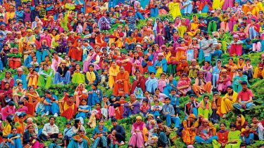 A large group of people wearing colourful clothing