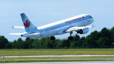 Air Canada plane taking off from runway