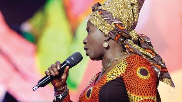 Angélique Kidjo singing on stage