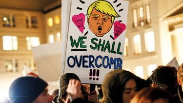 Anti-Trump demonstrators holding placard