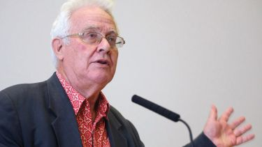 Benedict Anderson speaking at lectern