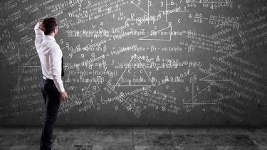 Blackboard covered in maths equations