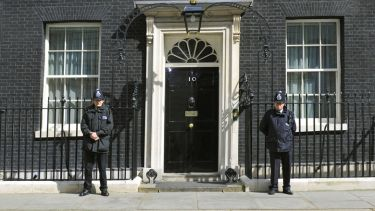 British police officers guarding 10 Downing Street entrance, London