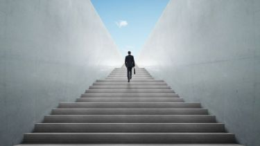 Businessman climbing stairs