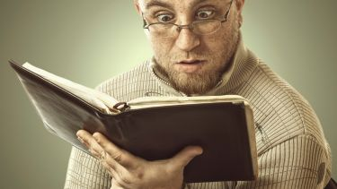 Confused man reading book