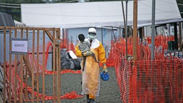 Ebola doctor with child
