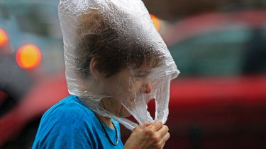 Hungarian woman wearing a plastic bag in the rain
