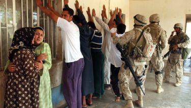 Iraqi family stand detained by US Marines