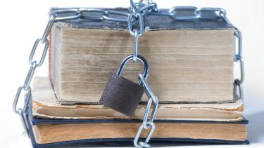 'Copyright' padlock around book