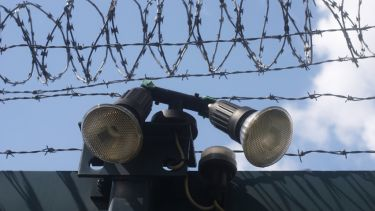 Razor wire and searchlights