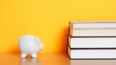 Piggy bank and books
